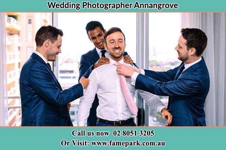 Photo of the Groom being help by the groomsmen to get ready Annangrove NSW 2156