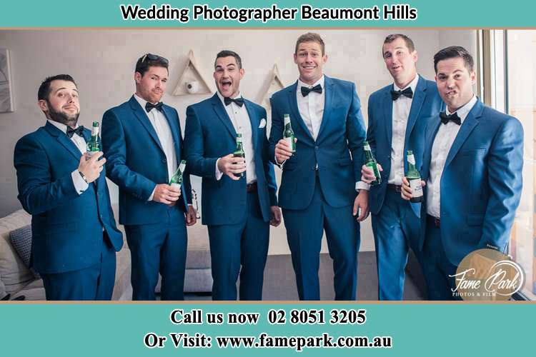 The groom and his groomsmen striking a wacky pose in front of the camera Beaumont Hills NSW 2155