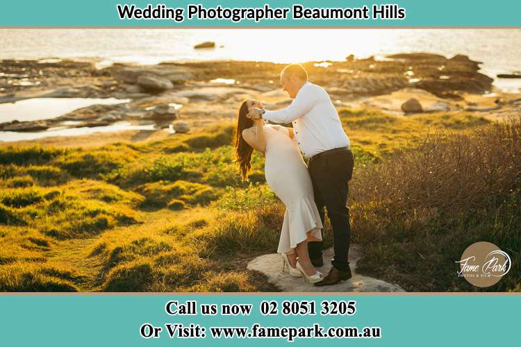 Photo of the Bride and the Groom dancing near the lake Beaumont Hills NSW 2155