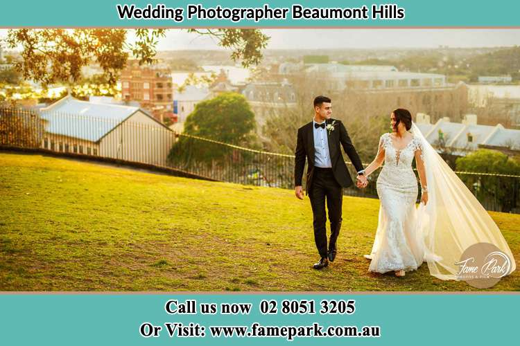 Photo of the Groom and the Bride walking at the yard Beaumont Hills NSW 2155