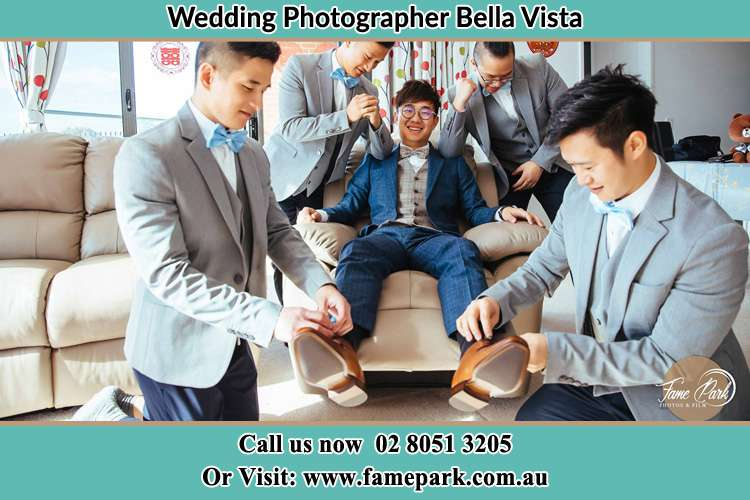 Photo of the Groom helping by the groomsmen getting ready Bella Vista NSW 2153