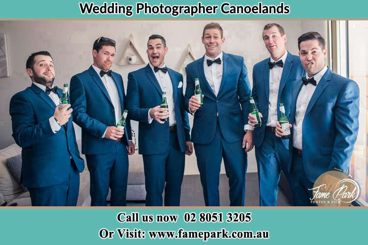 The groom and his groomsmen striking a wacky pose in front of the camera Canoelands NSW 2157