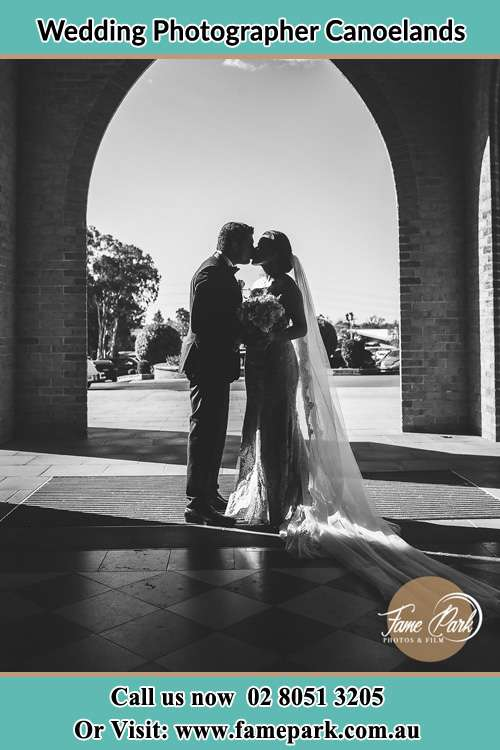 Photo of the Groom and the Bride kissing at the front of the church Canoelands NSW 2157