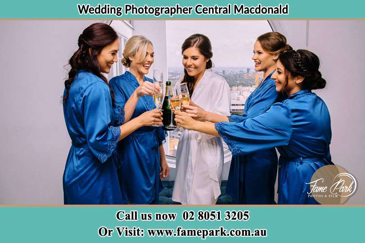 Photo of the Bride and the bridesmaids having wine Central Macdonald NSW 2775