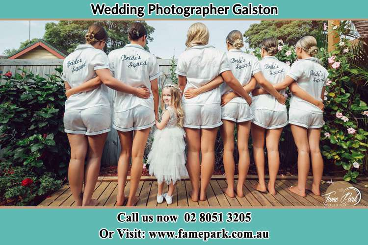 Behind photo of the Bride and the bridesmaids with the flower girl looking back Galston NSW 2159