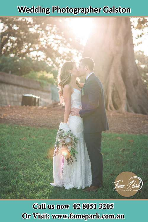 Photo of the Bride and the Groom kissing at the yard Galston NSW 2159