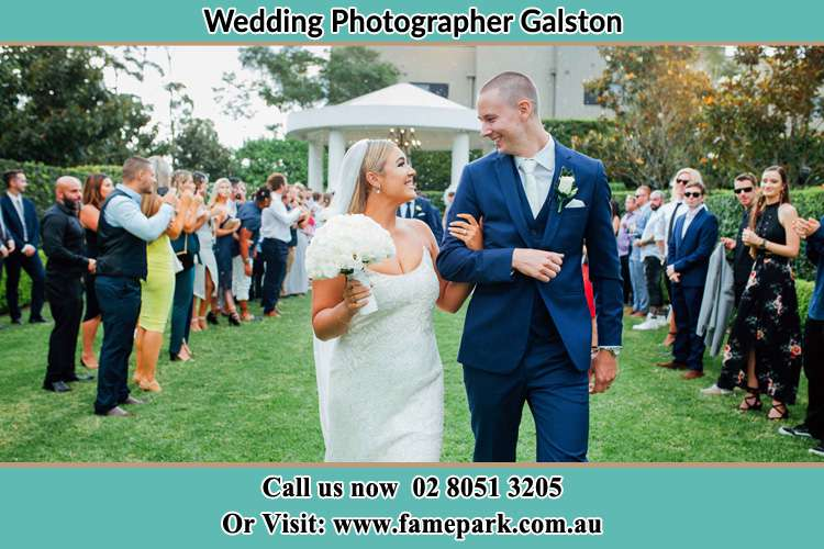 Photo of the Bride and the Groom looking each other while walking Galston NSW 2159