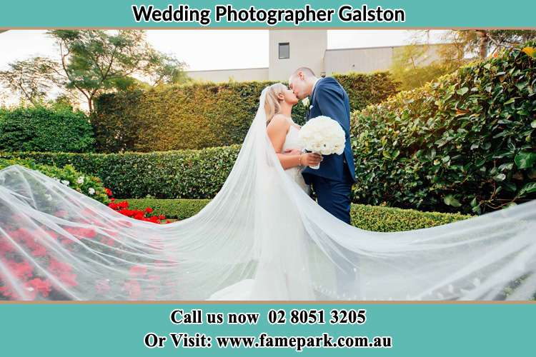 Photo of the Bride and the Groom kissing at the garden Galston NSW 2159