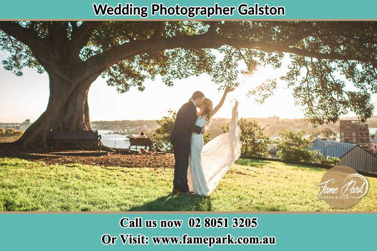 Photo of the Groom and the Bride kissing under the tree Galston NSW 2159