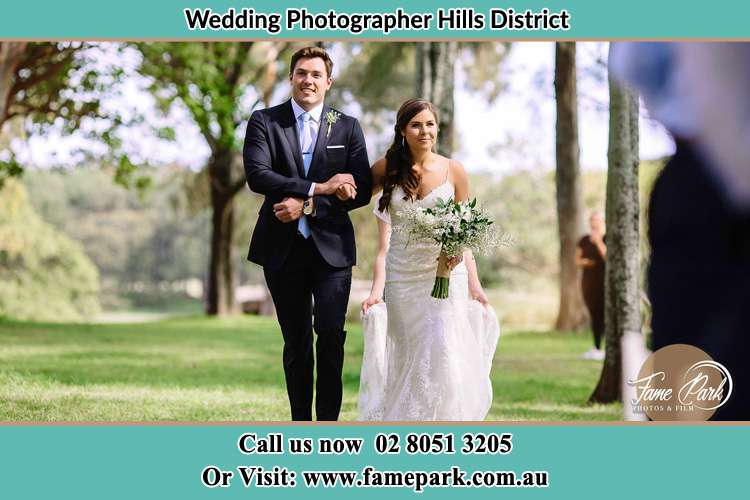 Photo of the Bride and Groom outside the yard Hills District