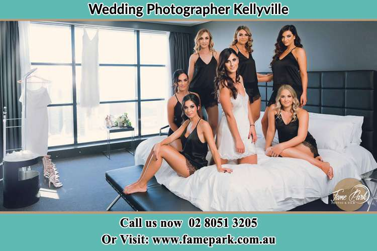 Photo of the Brides and the bridesmaids wearing lingerie on bed Kellyville NSW 2155