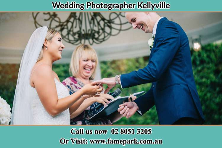Photo of the Bride wearing ring to the Groom Kellyville NSW 2155