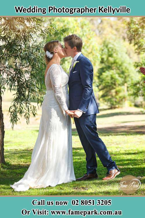 Photo of the Groom and the Bride kissing at the yard Kellyville NSW 2155