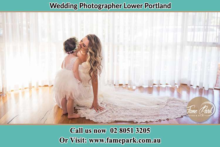 Photo of the Bride kissing the flower girl Lower Portland NSW 2756