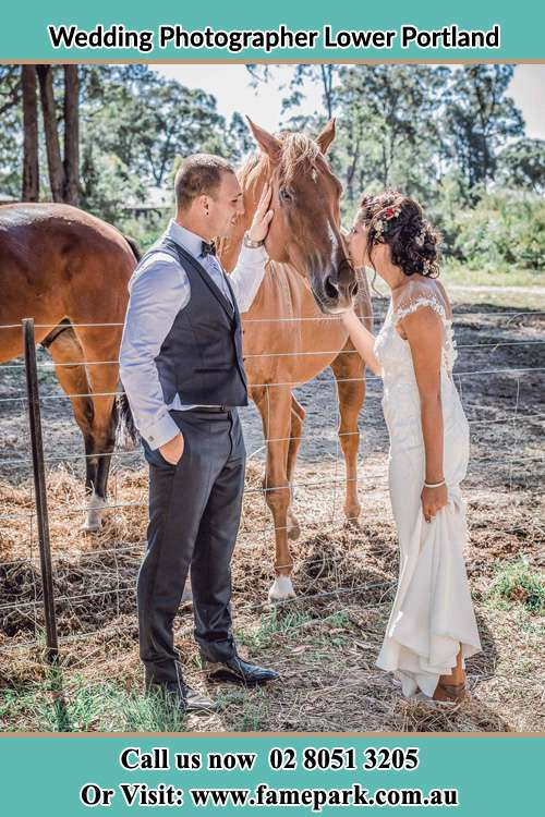 Photo of the Groom holding the horse and kiss by the Bride Lower Portland NSW 2756