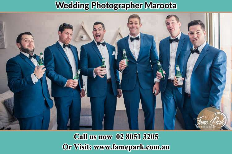 The groom and his groomsmen striking a wacky pose in front of the camera Maroota NSW 2756