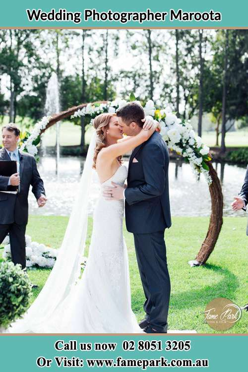 Photo of the Bride and the Groom kissing Maroota NSW 2756
