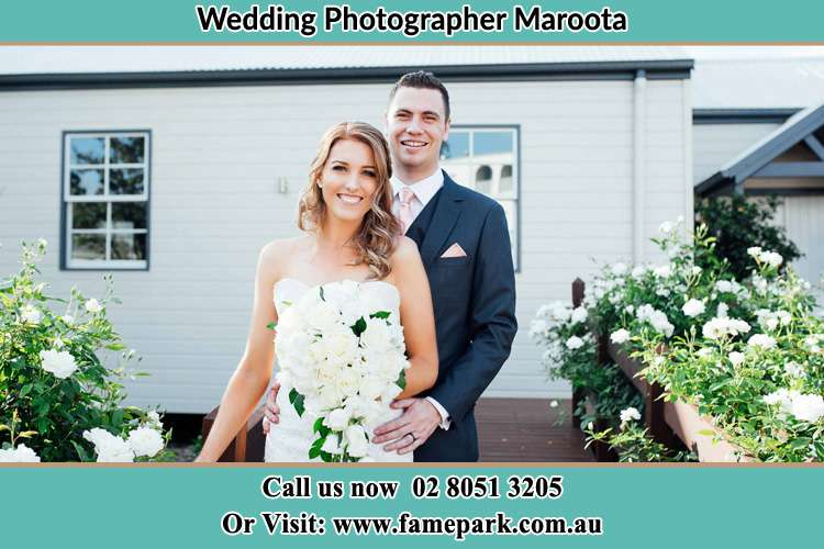 The Bride and the Groom smiling on the camera Maroota NSW 2756