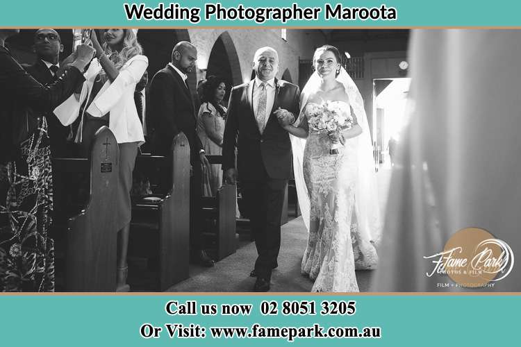 Photo of the Bride and her father walking the aisle Maroota NSW 2756