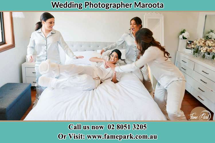 Photo of the Bride and the bridesmaids playing on bed Maroota NSW 2756