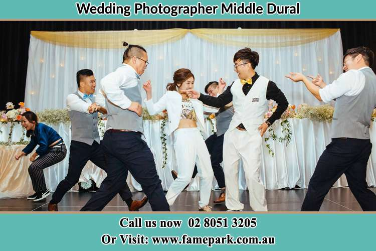 Photo of the Bride and the Groom dancing with the groomsmen Middle Dural NSW 2158