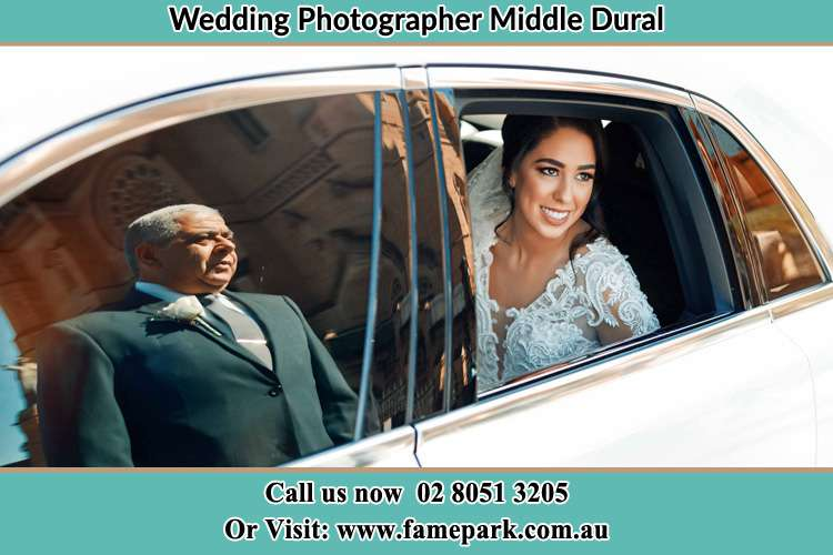 Photo of the Bride inside the bridal car and her father standing outside Middle Dural NSW 2158