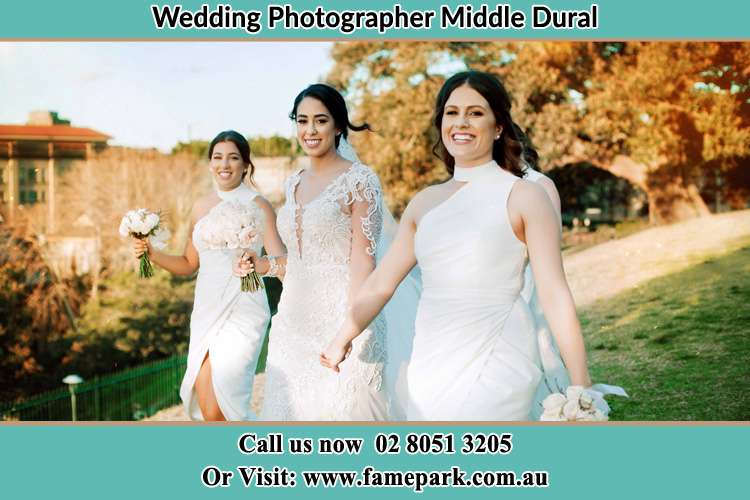 Photo of the Bride and the bridesmaids walking Middle Dural NSW 2158