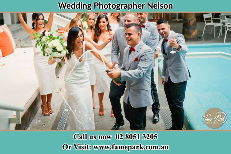 Photo of the Bride and the Groom celebrating with the secondary sponsors Nelson NSW 2765