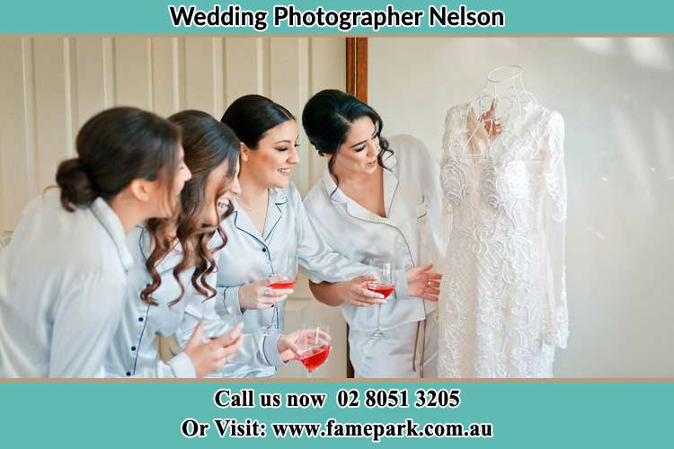 Photo of the Bride and the bridesmaids looking at the wedding gown Nelson NSW 2765