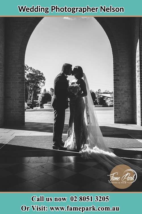 Photo of the Groom and the Bride kissing at the front of the church Nelson NSW 2765