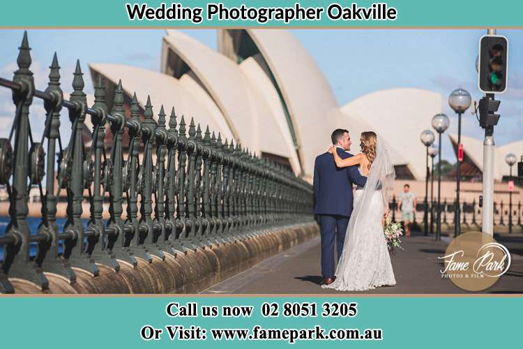 The Groom and the Bride walking towards the Sydney Grand Opera House Oakville NSW 2765