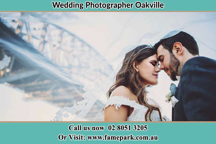 Close up photo of the Bride and the Groom under the bridge Oakville NSW 2765
