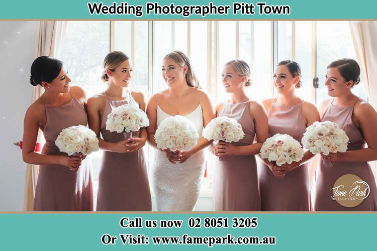 Photo of the Bride and the bridesmaids holding flower bouquet Pitt Town NSW 2756