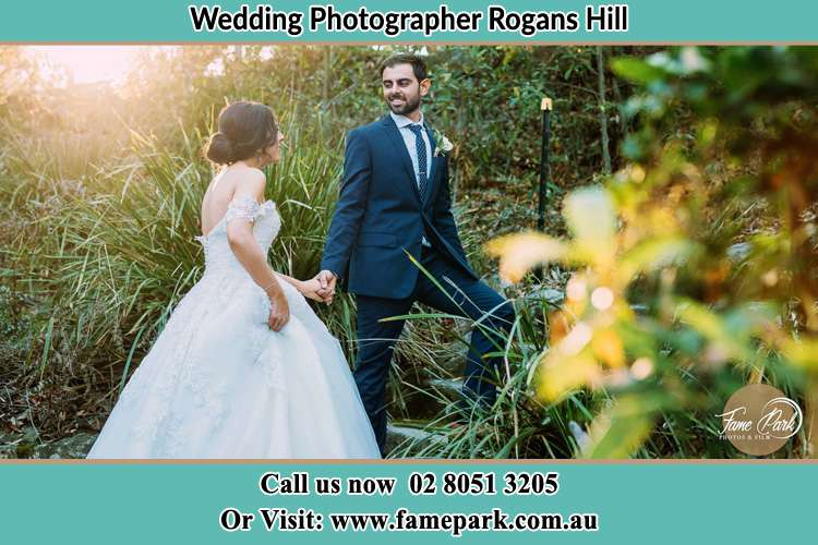 Photo of the Bride and the Groom going up hill Rogans Hill NSW 2154