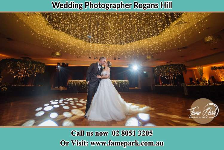 Photo of the Groom and the Bride kissing on the dance floor Rogans Hill NSW 2154