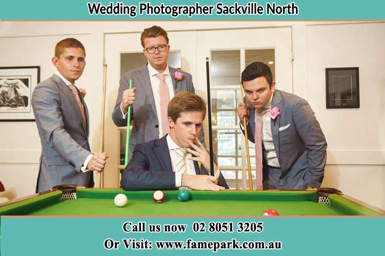 Photo of the Groom and the groomsmen playing billiard Sackville North NSW 2756