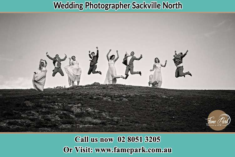 Jump shot photo of the Bride and the Groom with the secondary sponsors Sackville North NSW 2756