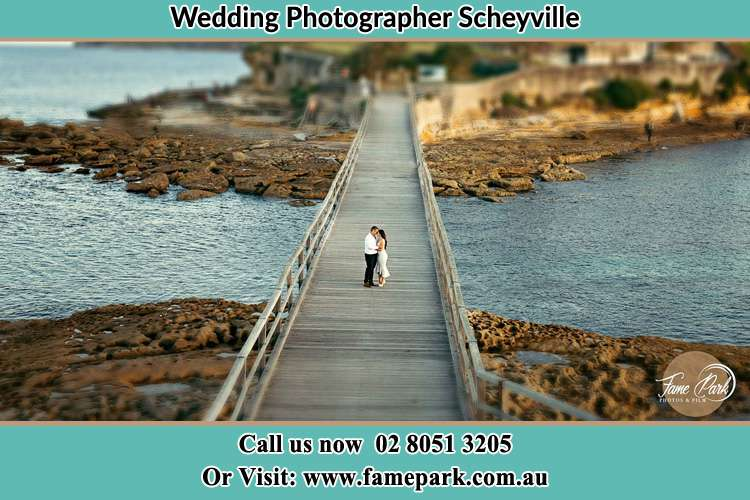 Photo of the Groom and the Bride at the bridge Scheyville NSW 2756