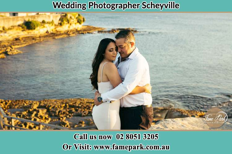 Photo of the Bride and the Groom hugging near the lake Scheyville NSW 2756