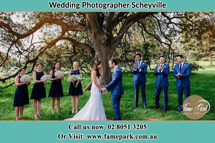Photo of the Bride and the Groom looking each other with the entourage Scheyville NSW 2756