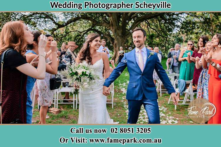 Photo of the Bride and the Groom showering bubble by the visitors Scheyville NSW 2756