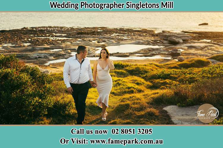 Photo of the Groom and the Bride walking near the lake Singletons Mill NSW 2775