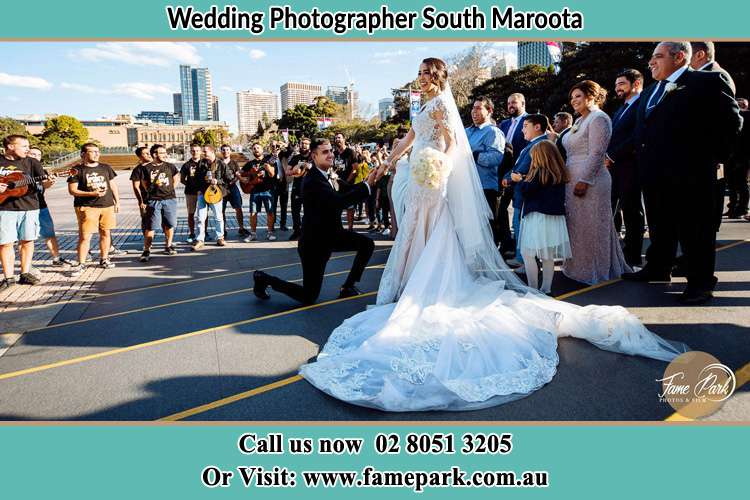 Groom Kneeling down infront of the Bride South Maroota NSW 2756