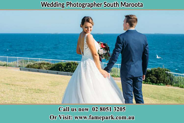 Photo of the Bride and the Groom holding hands at the yard South Maroota NSW 2756
