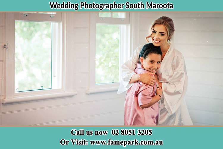 Photo of the Bride hugging the flower girl South Maroota NSW 2756