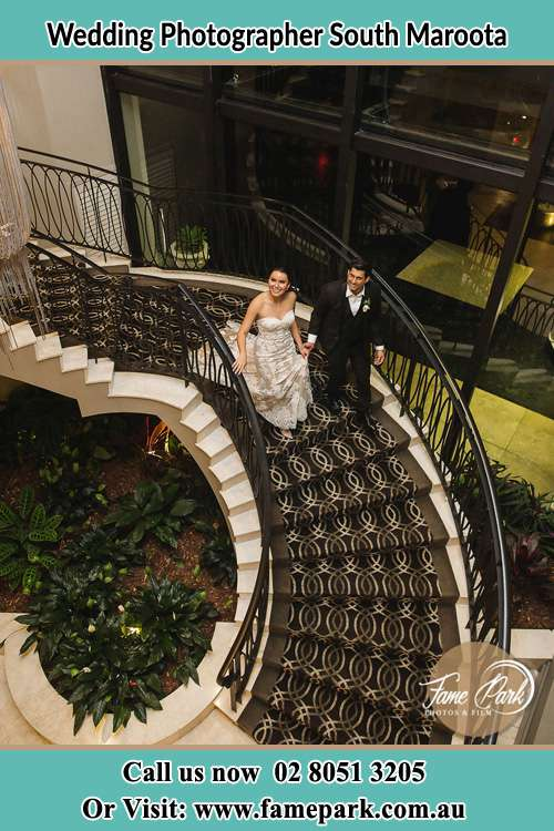Photo of the Bride and the Groom going down the stair South Maroota NSW 2756