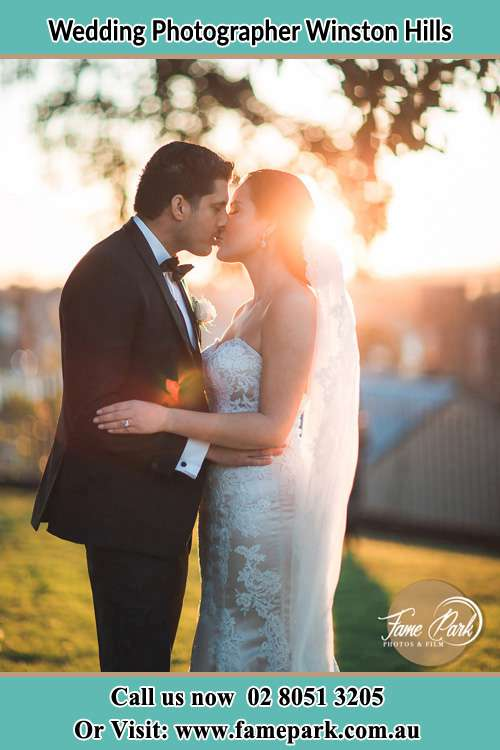 Photo of the Groom and the Bride kissing at the yard Winston Hills NSW 2153