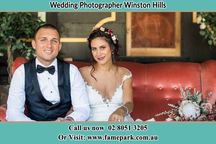 The Groom and the Bride sitting and smiling on camera Winston Hills NSW 2153