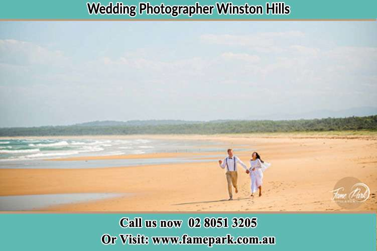 Photo of the Groom and the Bride walking the sea shore Winston Hills NSW 2153